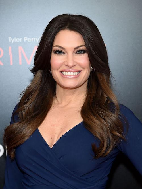 Kimberly Guilfoyle smiling while in a blue dress.