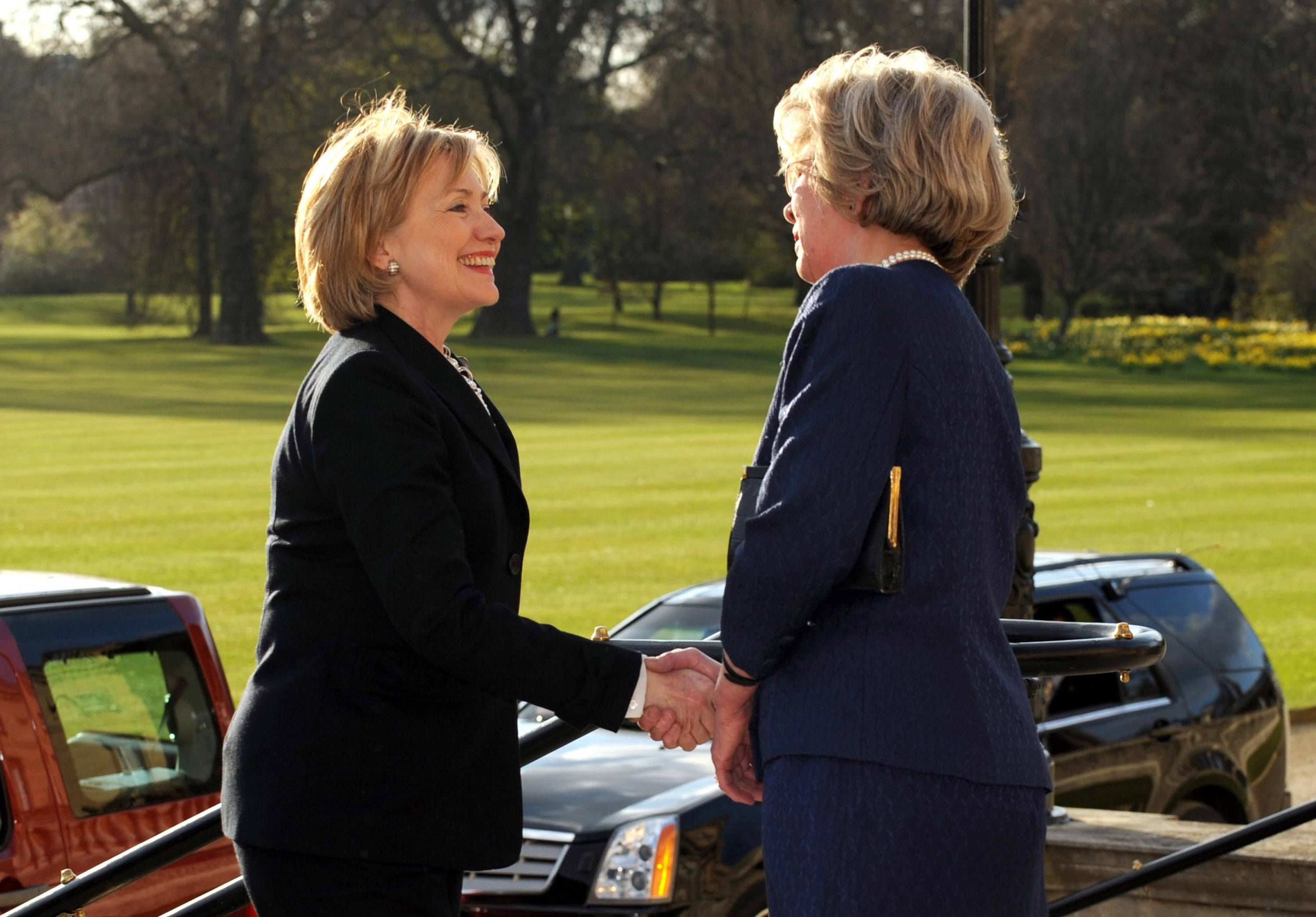 Secretary of State Hillary Clinton is greeted by Mrs Jennifer Gordon-Lennox, Lady In Waiting