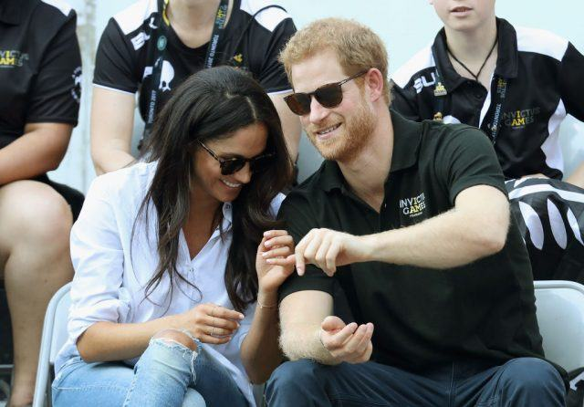 Prince Harry and Meghan Markle (L) attend a Wheelchair Tennis match during the Invictus Games