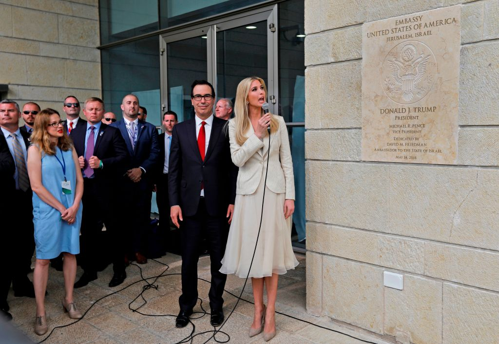 Steve Mnuchin and Ivanka Trump unveil an inauguration plaque during the opening of the US embassy