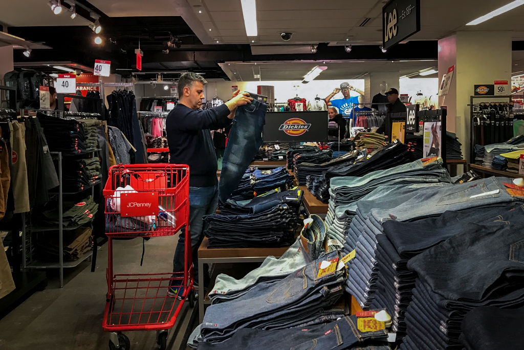 A man shops for jeans in a JCPenny store at the Manhattan Mall