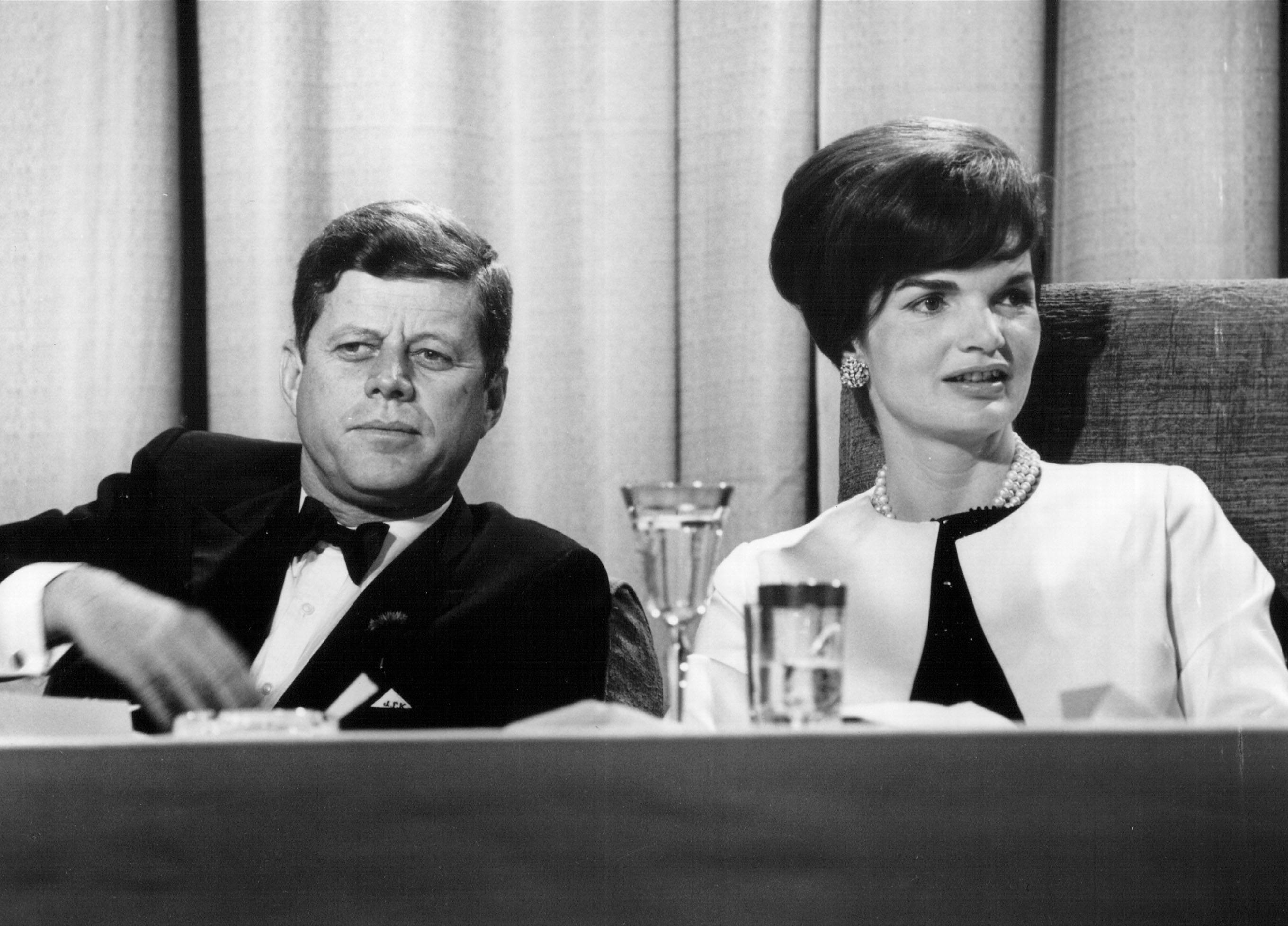 President John F. Kennedy and First Lady Jackie Kennedy seated at a table