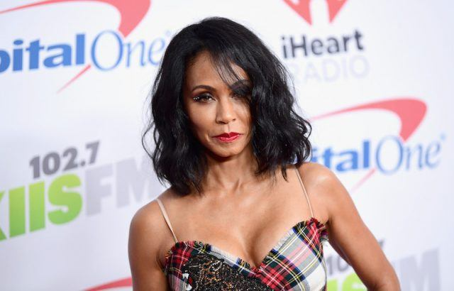 Jada Pinkett Smith looking sultry on a red carpet.