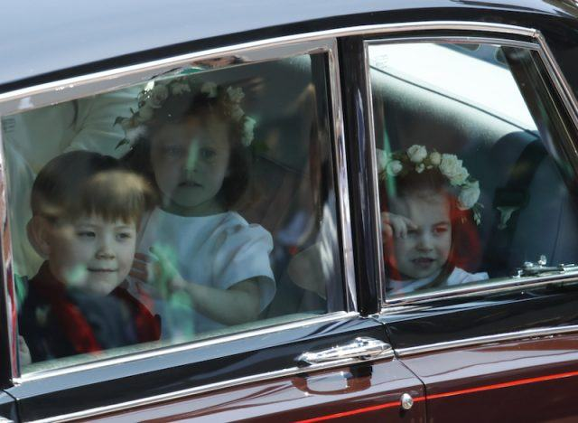 The pageboy sitting with the bridesmaids.