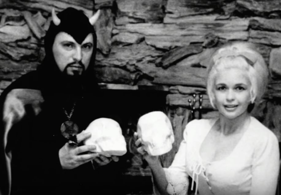 High priest of the Church of Satan poses with actress Jayne Mansfield.