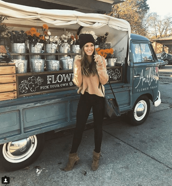 "JoJo Fletcher from ""The Bachelorette"" outside with flowers"