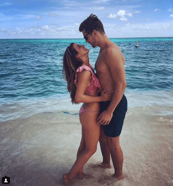 "JoJo Fletcher and Jordan Rodgers from ""The Bachelorette"" standing on the beach"