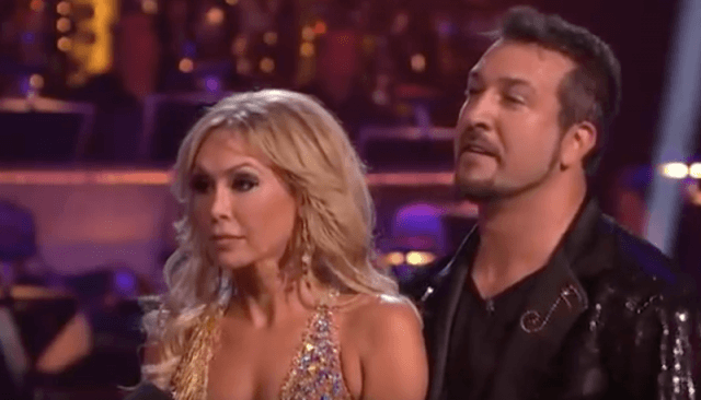 Joey Fatone and Kym Johnson listening to the judges on 'DWTS'.