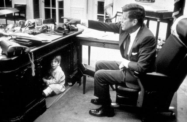 John F. Kennedy Jr. in the Oval Office
