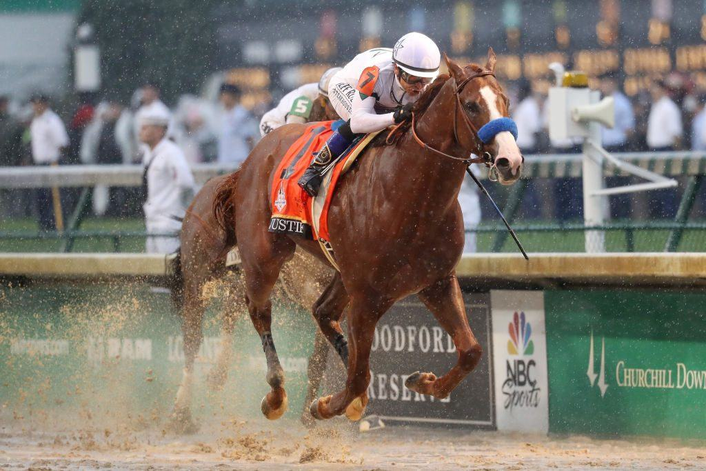 Justify #7, ridden by jockey Mike Smith crosses the finish line to win the 144th running of the Kentucky Derby