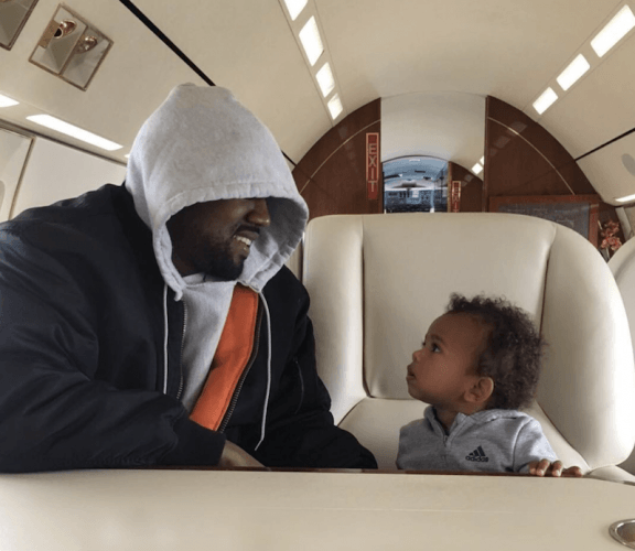 Kanye and his son in their private plane.