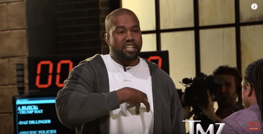 Kanye talking to TMZ for an interview
