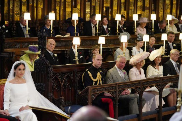 Meghan Markle sits next to the royal family.