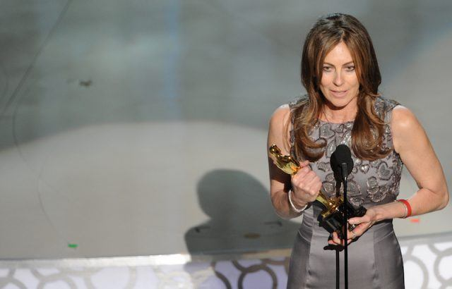 Kathryn Bigelow accepting an award on stage.