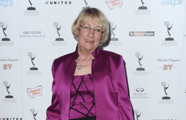 Kathryn Joosten wearing a pink outfit on a red carpet.