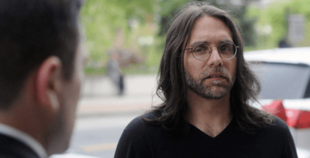 Keith Raniere being interviewed by a reporter.