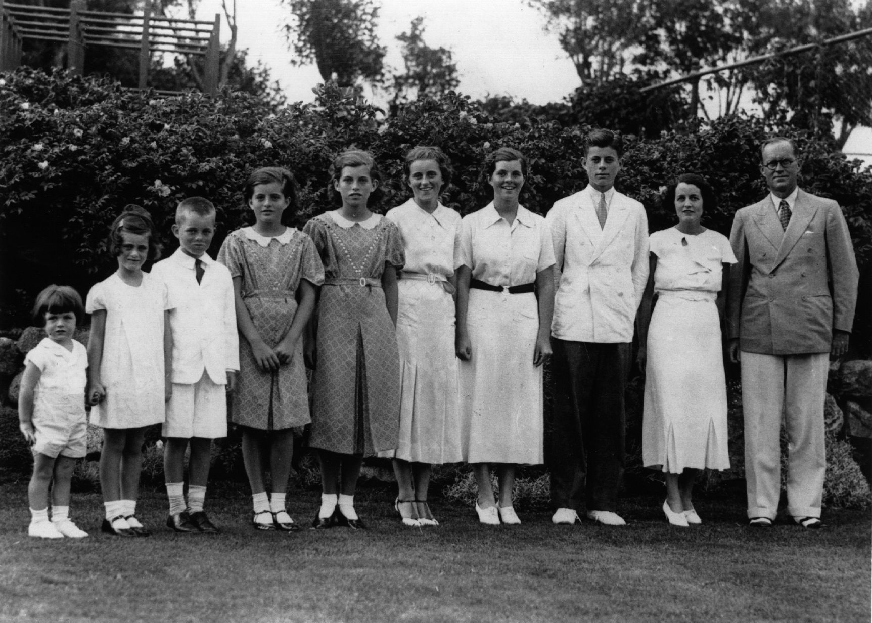American multi-millionaire Joseph Patrick Kennedy (right), the newly-appointed ambassador to London, with his wife Rose Kennedy (second from right) and eight of their nine children, in London. From left: Edward, Jeanne, Robert, Patricia (1924 - 2006), Eunice, Kathleen, Rosemary and John F Kennedy
