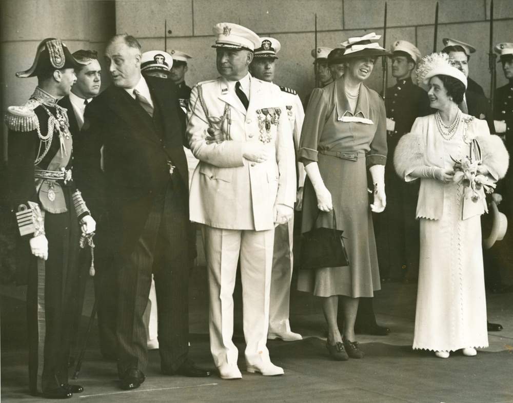 President Roosevelt in conversation with King George VI while Eleanor Roosevelt and Queen Elizabeth exchange pleasantries at Union Station.