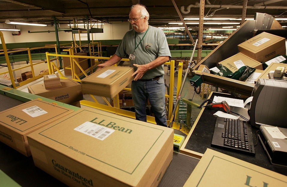 Tom Morrison sorts boxed orders in the L.L. Bean shipping center