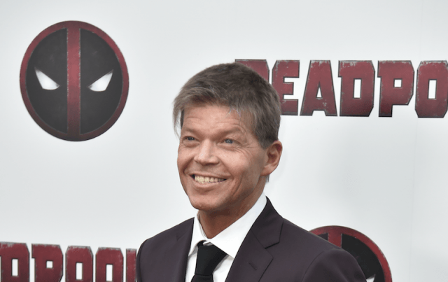 Rob Liefeld smiling on a red carpet.
