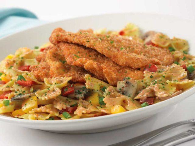 Breaded chicken on top of pasta.