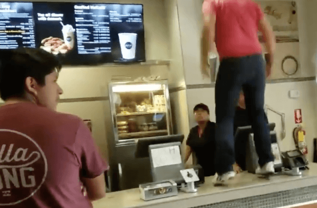 A customer on top of a McDonald's counter.