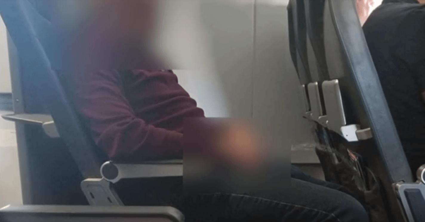 Man urinating on seat on plane