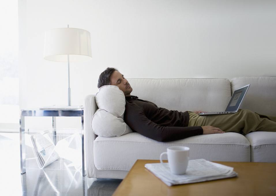 Man taking a nap in his office