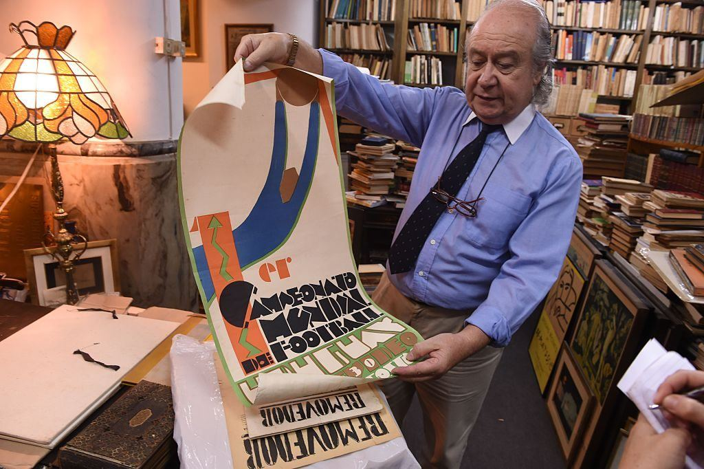 Bookseller Roberto Cataldo shows an original poster of the first Football World Cup played in Uruguay in 1930, at his antique bookshop in Montevideo, on January 12, 2016
