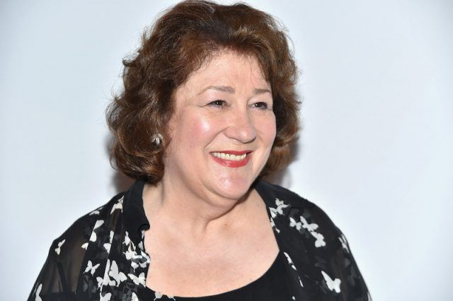 Margo Martindale smiling while in a black and white dress.