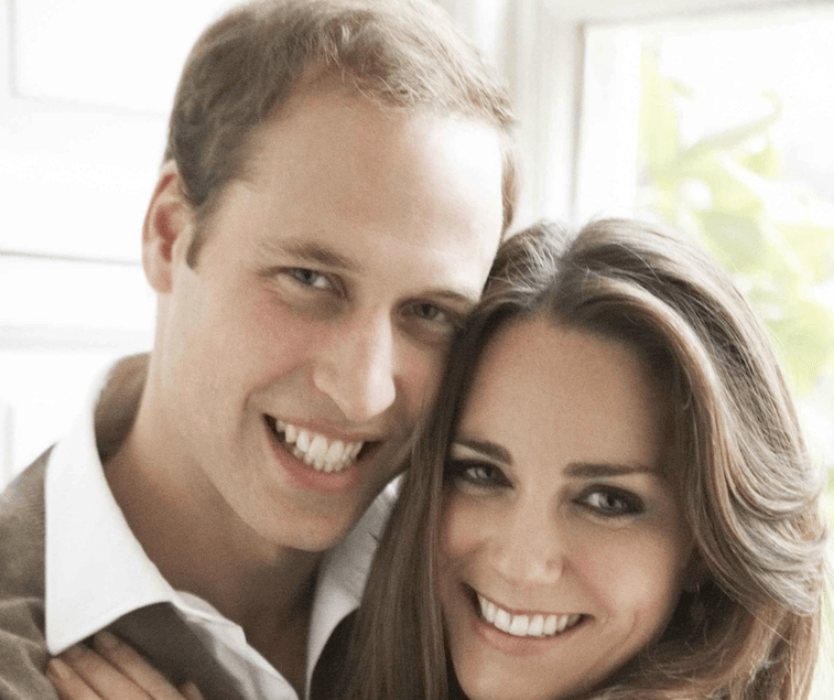 Prince William smiling with Kate Middleton.