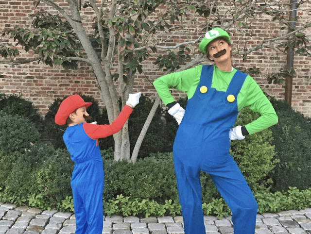Gisele Bündchen and her son in costumes.