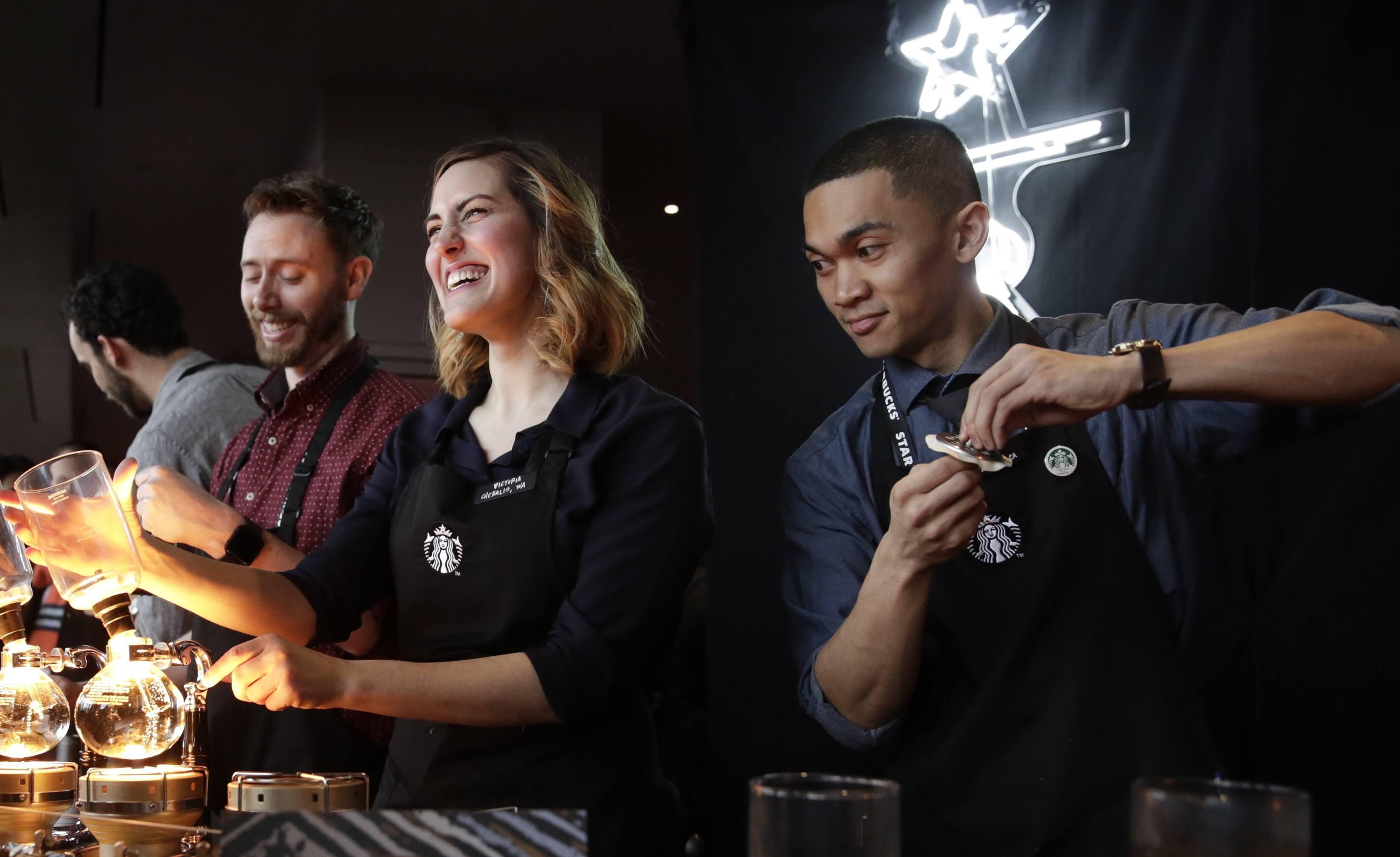 Baristas brew siphon coffee at Starbucks' Annual Meeting