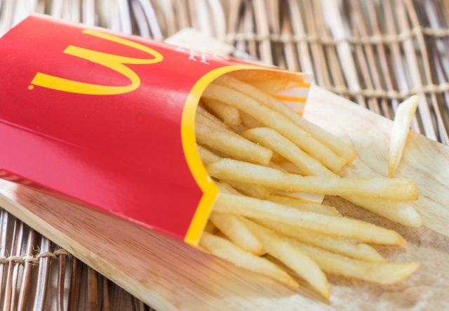 A pack of fries on a table