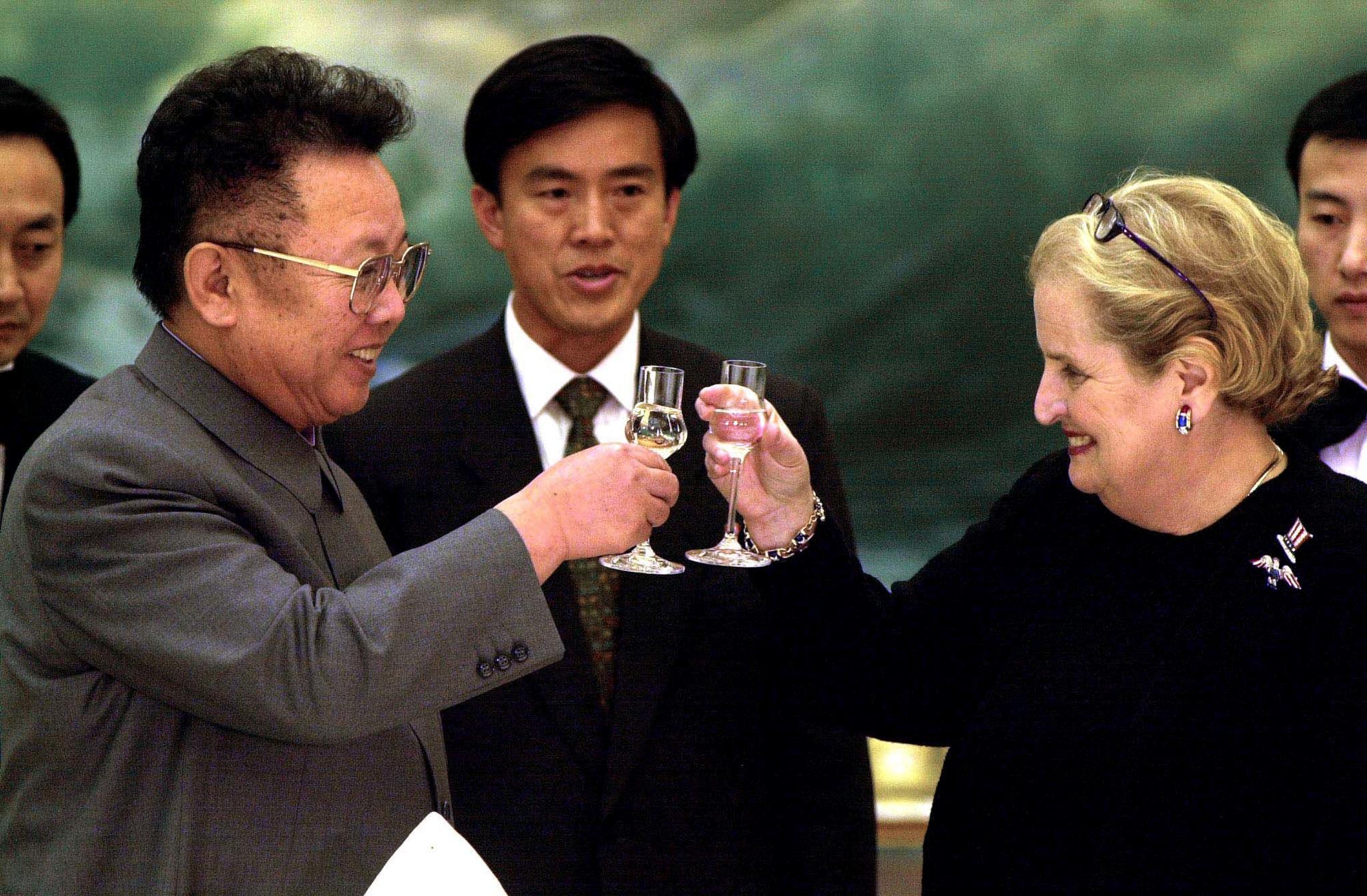 North Korean leader Kim Jong Il (L) toasts US Secretary of State Madeleine Albright