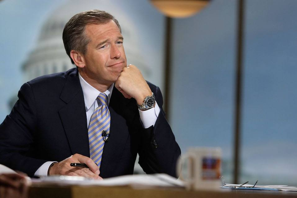Moderator Brian Williams watches a video which pays tribute to late moderator Tim Russert
