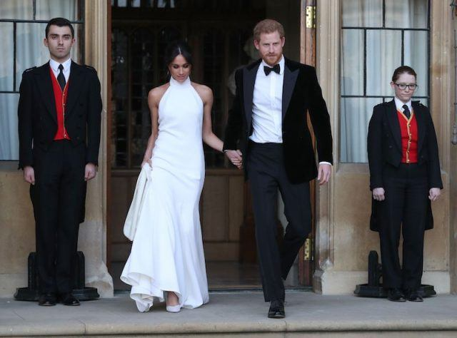 Prince Harry walking out of the church with Meghan Markle.