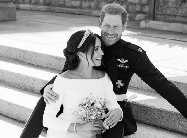 Prince Harry and Meghan Markle on the steps.