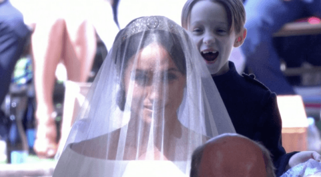 The pageboy smiling behind Meghan Markle.