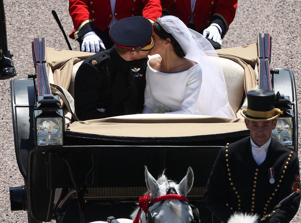 Meghan Markle and Prince Harry carriage kiss