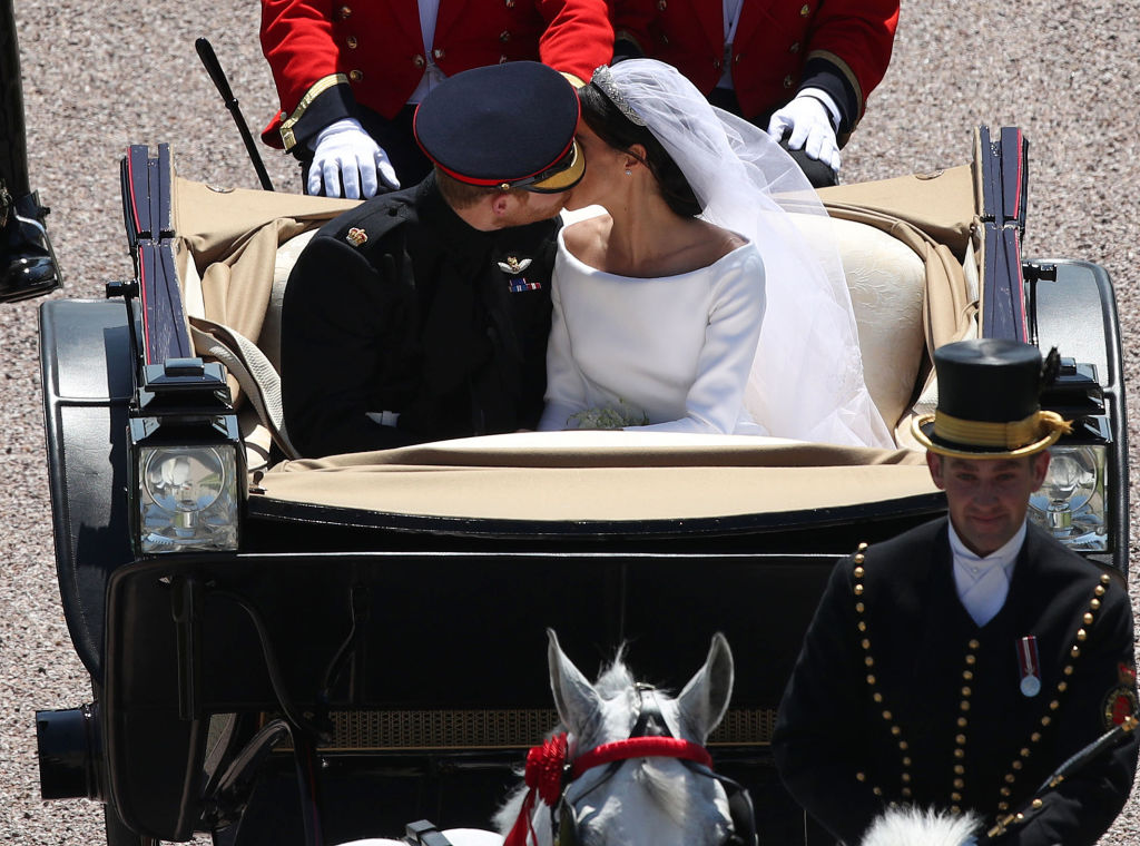 Meghan Markle and Prince Harry carriage kiss