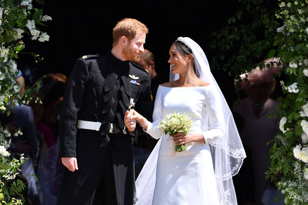 Britain's Prince Harry, Duke of Sussex and his wife Meghan, Duchess of Sussex leave from the West Door of St George's Chapel