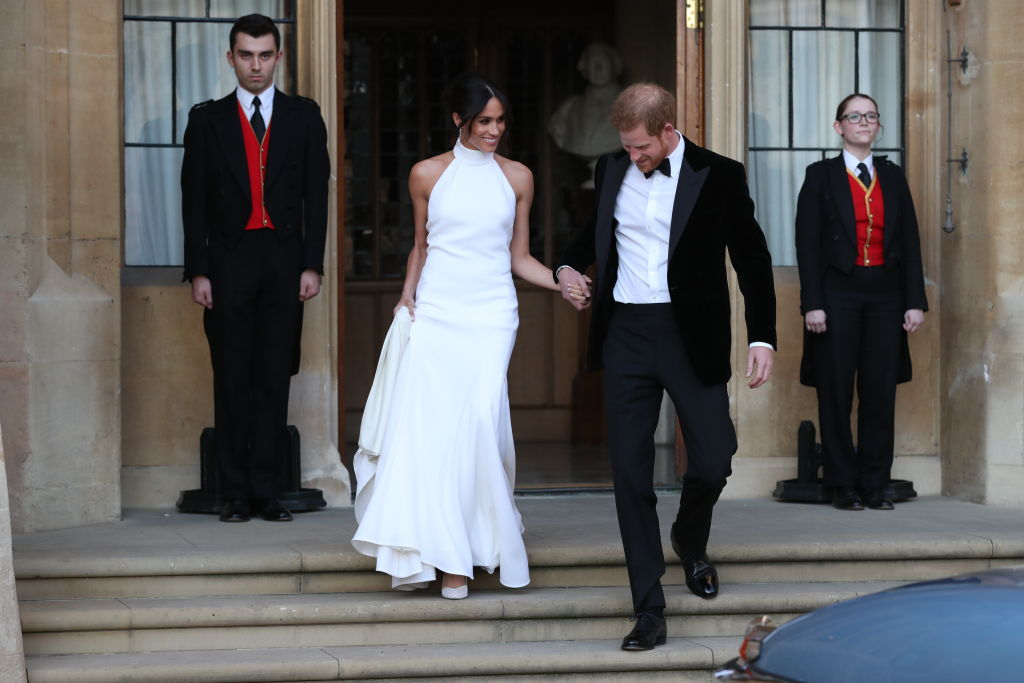 Duchess of Sussex and Prince Harry, Duke of Sussex leave Windsor Castle after their wedding to attend an evening reception at Frogmore House