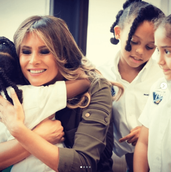 Melania Trump hugging a child at a youth center