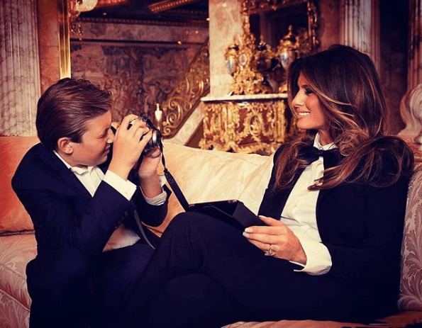 Melania Trump being photographed by Barron