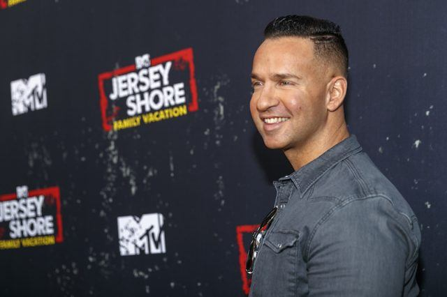 Mike Sorrentino smiling on a red carpet.