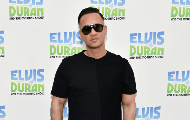 Mike Sorrentino posing on a red carpet.