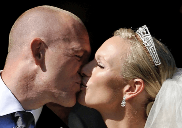 Mike Tindall and Zara Phillips kiss on their wedding day.