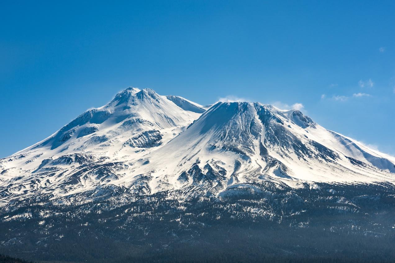 Snowcapped Mount Shasta volcano during winter blue closeup