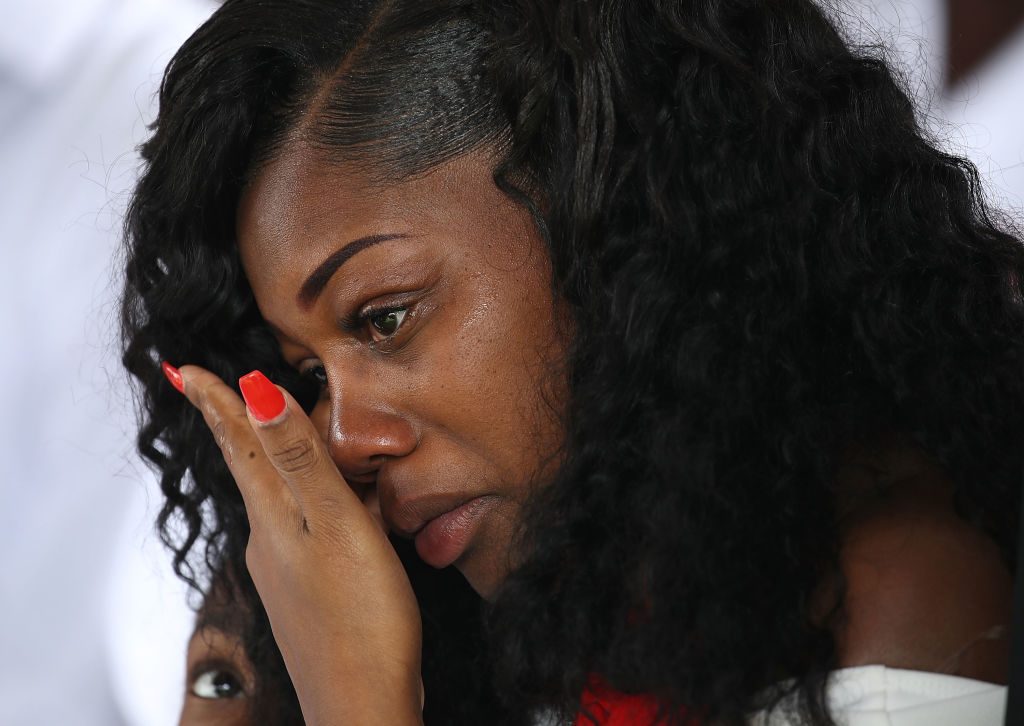 Myeshia Johnson wipes away tears during the burial service for her husband U.S. Army Sgt. La David Johnson